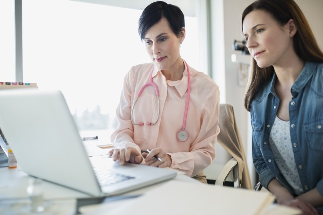 doctor and patient using a laptop